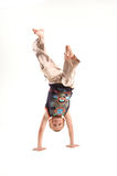 Jumping boy on the white background Royalty Free Stock Image