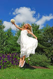 Jumping bride stock photos