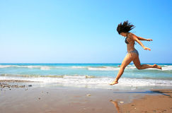 Jumping brunette girl Stock Image
