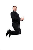 Jumping business man. Business man jumping with thumbs up isolated over a white background royalty free stock images