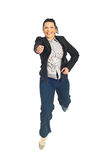 Jumping business woman with attitude Royalty Free Stock Images