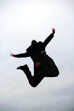 Jumping businessman. Business man jumping high in the sky Royalty Free Stock Photo