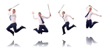 The jumping businessman with baseball bat Stock Photo
