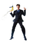 Jumping businessman holding drill Stock Photos