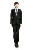 Jumping businessman, looking serious Royalty Free Stock Photo