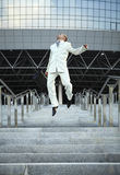 Jumping businessman over urban background Royalty Free Stock Photography
