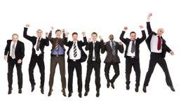 Jumping businessmen Stock Photos