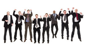 Jumping businessmen in a row Royalty Free Stock Images