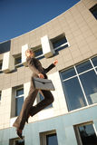 Jumping businesswoman Stock Photo