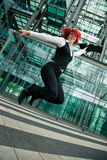 Jumping Businesswoman Stock Image