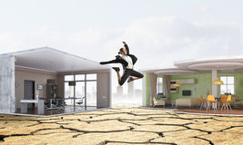 Jumping businesswoman in office. Mixed media . Mixed media Royalty Free Stock Images