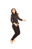 Jumping Businesswoman. Studio shot on white background of a jumping businesswoman Stock Photos
