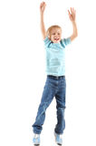 Jumping cheerful boy. Cheerful jumping 5 years old boy over white background Stock Photo