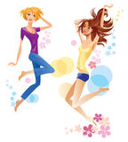 Jumping cheerful girls Royalty Free Stock Image