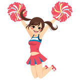 Jumping Cheerleader Girl. Young happy jumping cheerleader girl on uniform Royalty Free Stock Photo