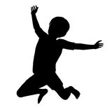 Jumping Child. Silhouette of a healthy young child jumping high into the air Stock Photos