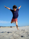 Jumping child. Happy boy jumping  in the beach Royalty Free Stock Photography