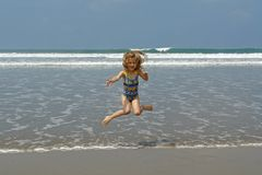 Jumping child on the beach. Pacific ocean. ecuador. south america stock images