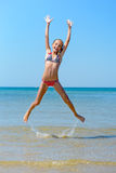 Jumping. Child jumping at the beach, full of energy Royalty Free Stock Images