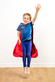 Jumping child flying like a fun super hero, saying hello Royalty Free Stock Image