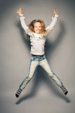 Jumping child Stock Images