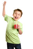 Jumping child holding healthy fruit juice Stock Images