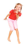 Jumping child in red shirt and  pants. Jumping child in red shirt and pink pants Royalty Free Stock Image
