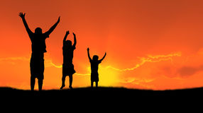 Jumping childen silhouette royalty free stock images