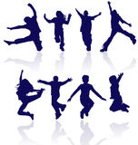 Group of happy school children active jumping dancing running playing kids kid child silhouettes fun sport party jumps jump dance