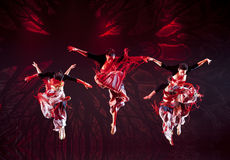 Jumping Chinese Yi national dancers Stock Image