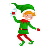 Jumping Christmas elf isolated with sweets in a green suit with, assistant of Santa Claus, boy helper holding candy for Royalty Free Stock Photos