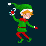 Jumping Christmas elf isolated with sweets in a green suit with, assistant of Santa Claus Stock Photography