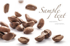 Jumping coffee beans Royalty Free Stock Photos