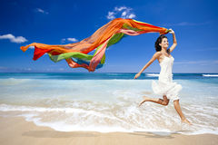 Jumping with a colored tissue Royalty Free Stock Photos
