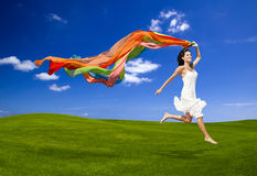 Jumping with a colored tissue Stock Image