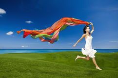 Jumping with colored tissues Stock Photos