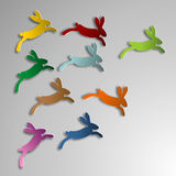 Jumping colorful rabbits Stock Photo