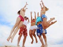 Jumping company Stock Photos