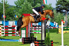 Jumping competition. Horse jumping hurdle at CSIO2*-W & Balkan Tour, Piatra Neamt (Romania) 4-7 june 2009. Gerry Flynn from Ireland on the horse ''Siec Goldrush Royalty Free Stock Photography