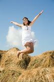 Jumping country girl stock photo