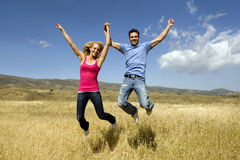Jumping couple Royalty Free Stock Photo