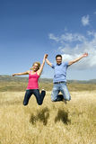 Jumping couple Stock Images