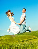 Jumping couple Royalty Free Stock Photos