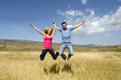 Jumping couple Stock Photos