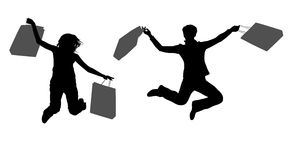 Jumping couple girls with bags Royalty Free Stock Images