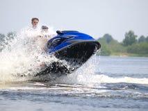Jumping couple men on jet ski. Couple men on jet ski jump on the wave Royalty Free Stock Images