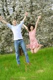 Jumping couple in nature Stock Images