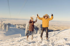 Jumping Couple with Snow Royalty Free Stock Photography