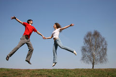 Jumping couple. spring. Royalty Free Stock Images