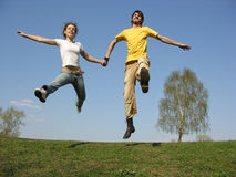 Jumping couple. spring Royalty Free Stock Image